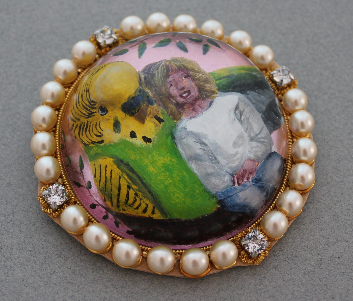 essex crystal reverse intaglio showing girl and budgie