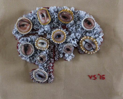 Image of textile brain and eye gems attached
