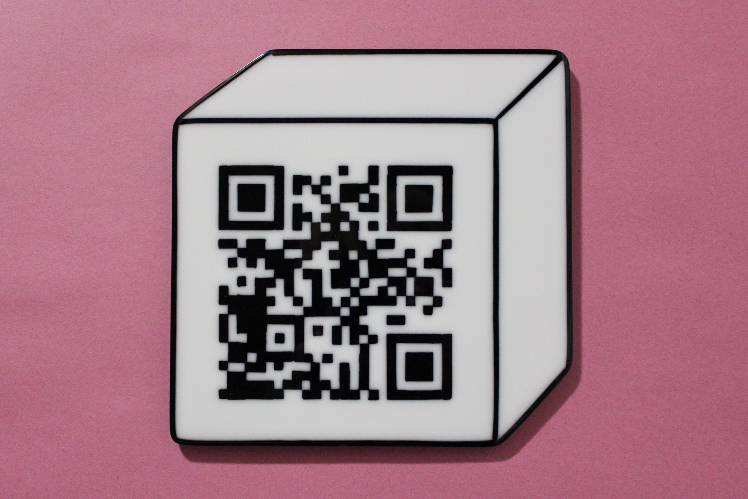 Flatpacked. Fused glass artwork showing a white cube and a QR code by Victoria Scholes