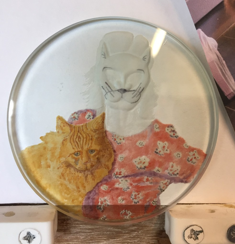 reverse intaglio carvingon flat glass with painting in progress