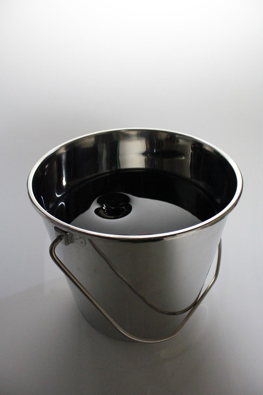 Untitled II. Fused glass looking like black oil in stainless steel bucket