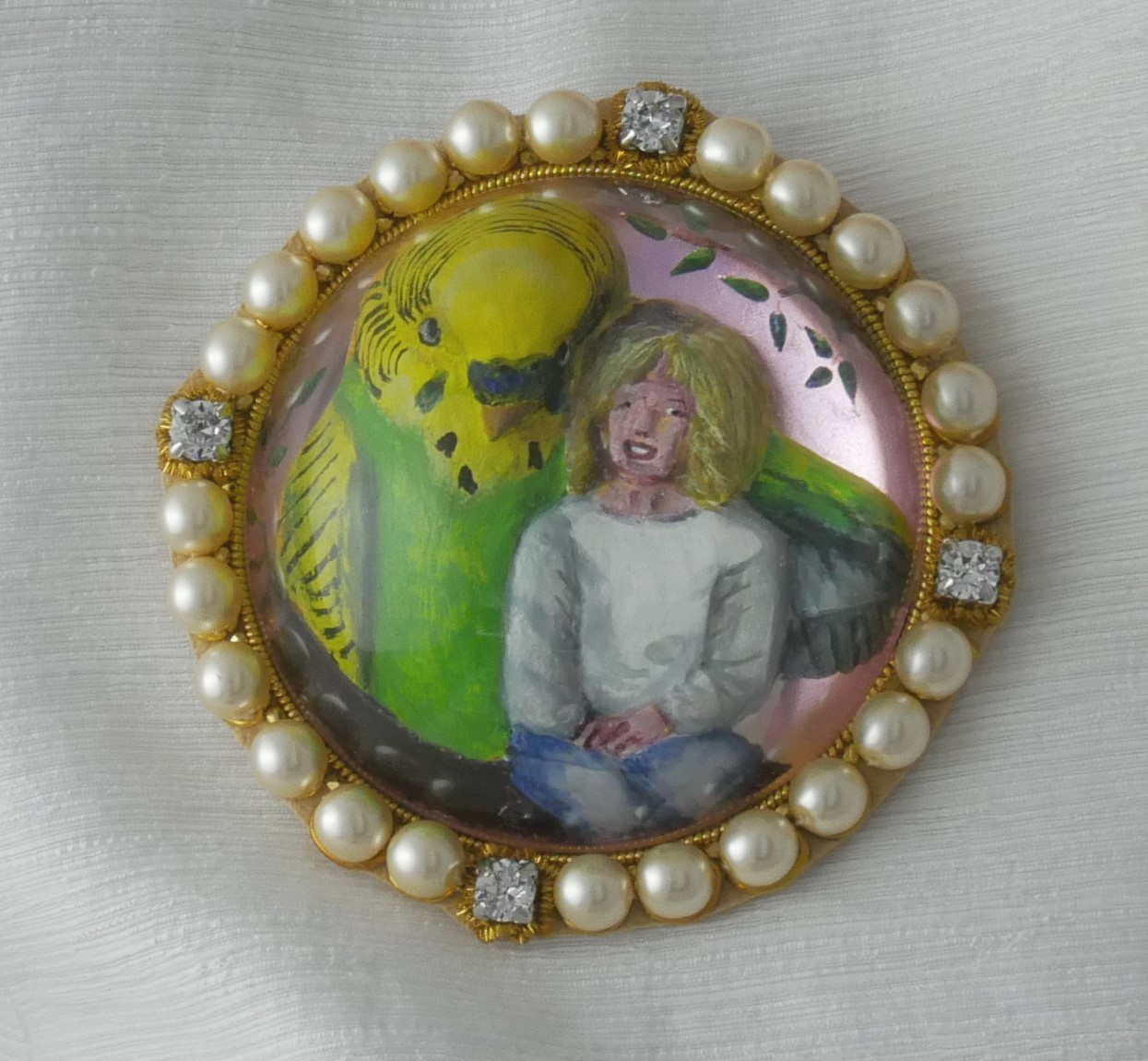 Reverse intaglio cast glass, carved and enamel painted crystal showing a large budieg alongside a small girl
